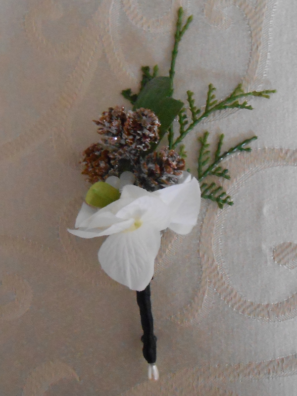White fresia winter boutonniere