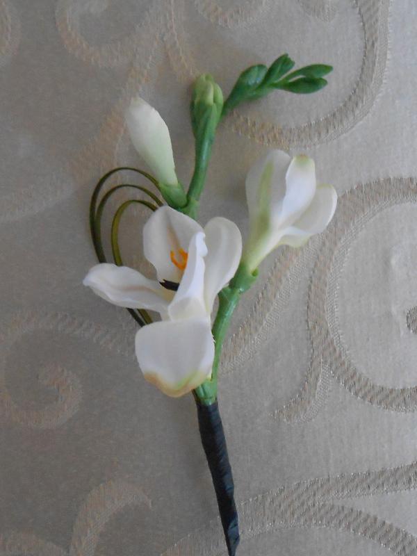 White fresia boutonniere
