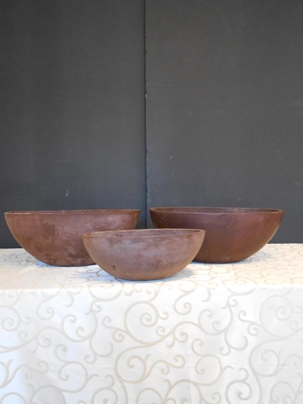 Brown fiberglass oval bowl