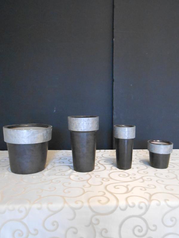 Black ceramic and zinc pot collection