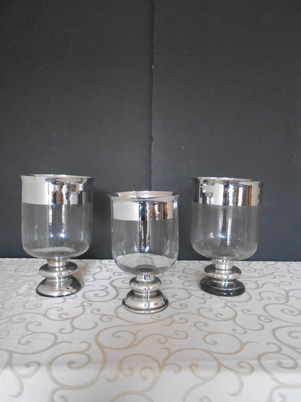 Footed glass vase with silver banding