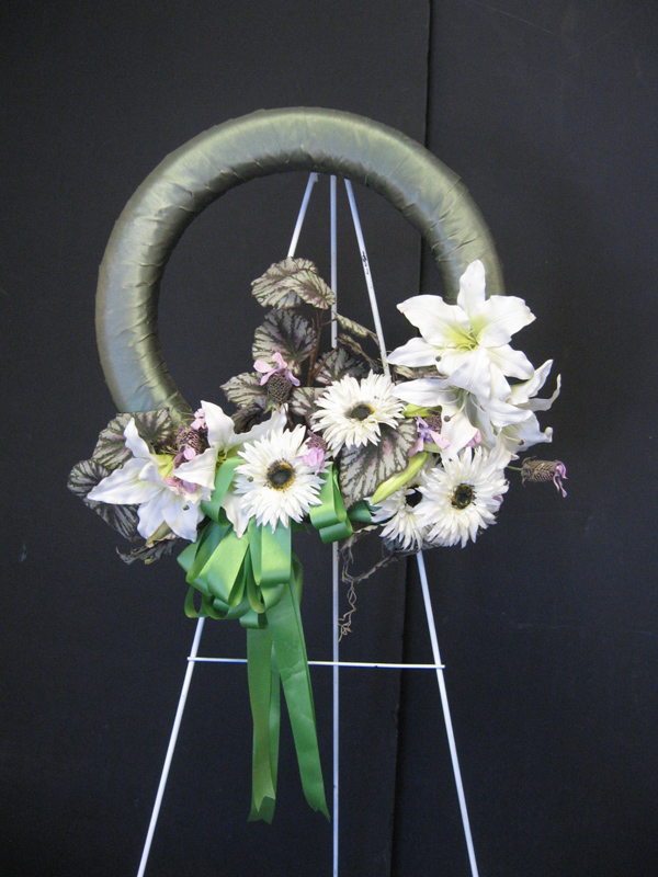 Green and white easel wreath