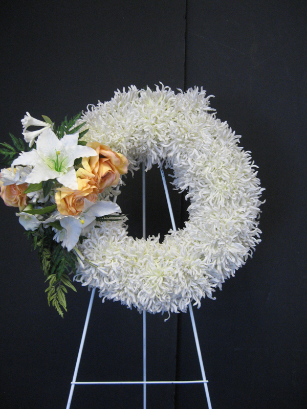 white wreath with yellow cluster