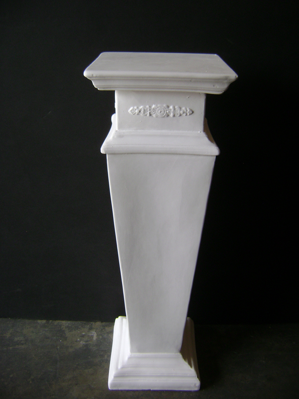 White plaster streamlined pedestal