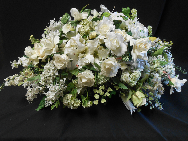 White rose light blue accents casket spray