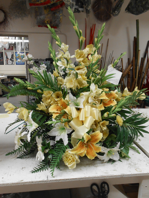 Yellow funeral floral