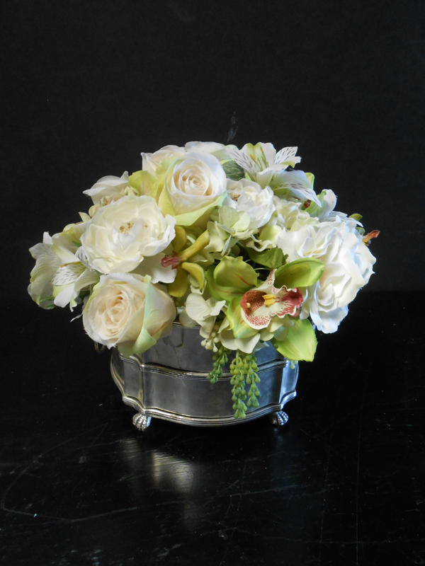 White roses green orchids in silver bowl