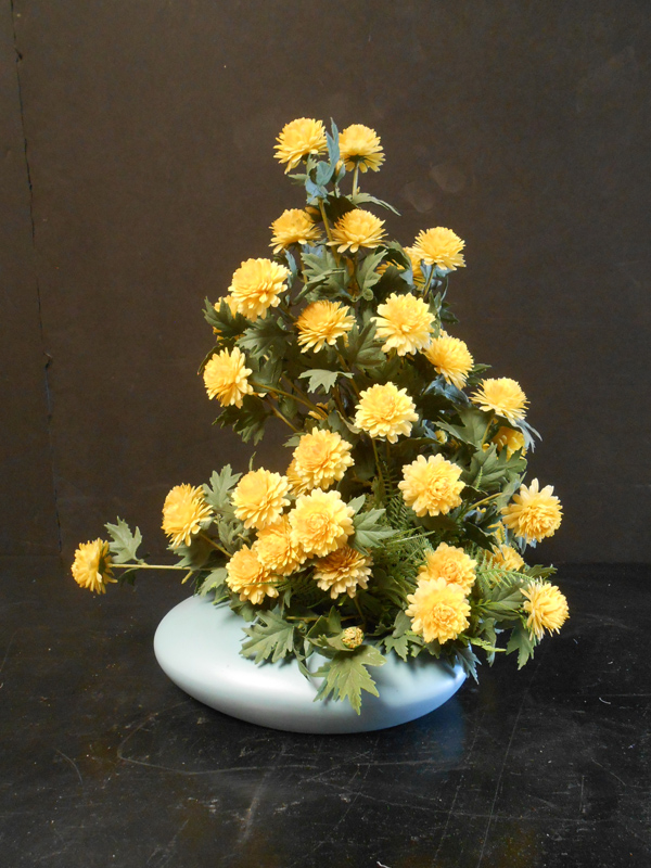 Vintage floral with yellow plastic mums
