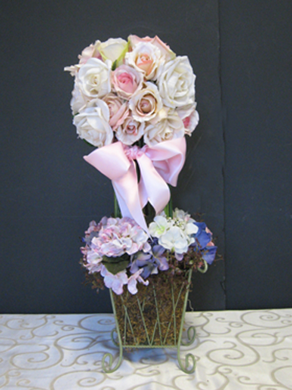 Pastel floral topiary in moss