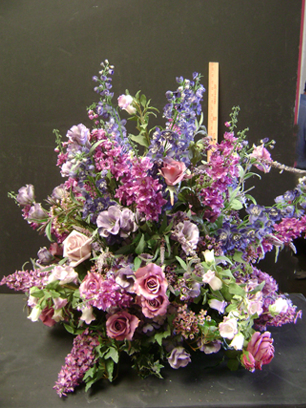 Purple and lavender funeral floral