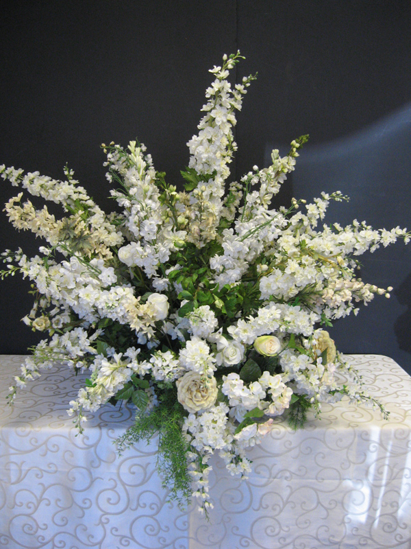 Wild and white funeral floral