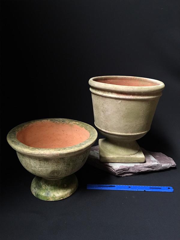 Aged terracotta urns
