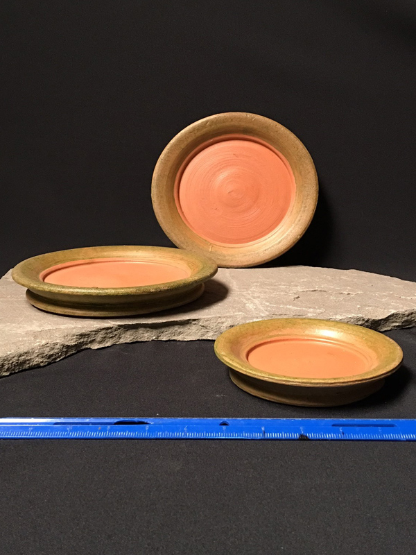 Aged terracotta saucers