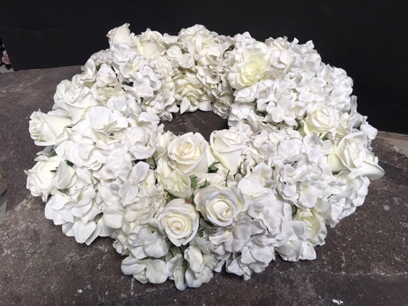 "White orchids and roses ""ring"" centerpiece."