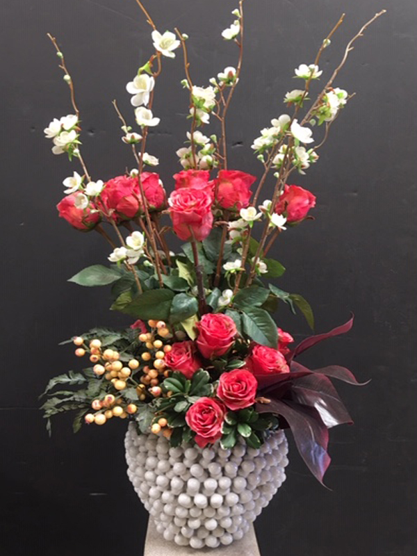 Dogwood and red roses topiary in white ceramic