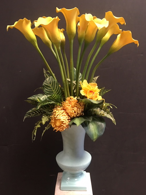 Gold callas topiary in turquoise vase
