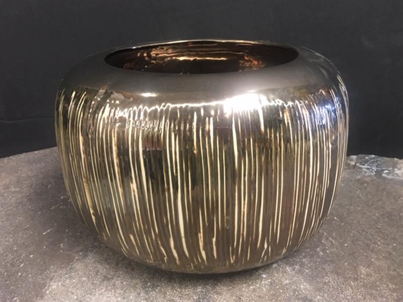 Gold textured ceramic bowl.
