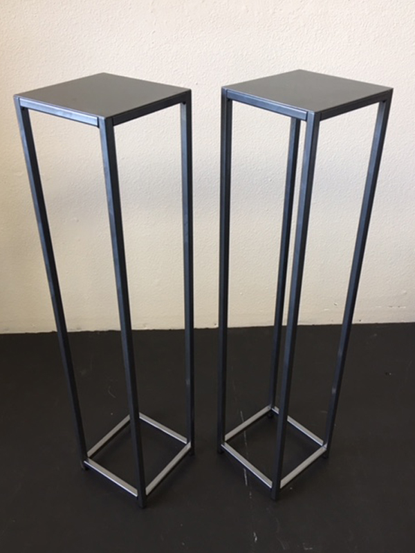 Dark metal pedestal