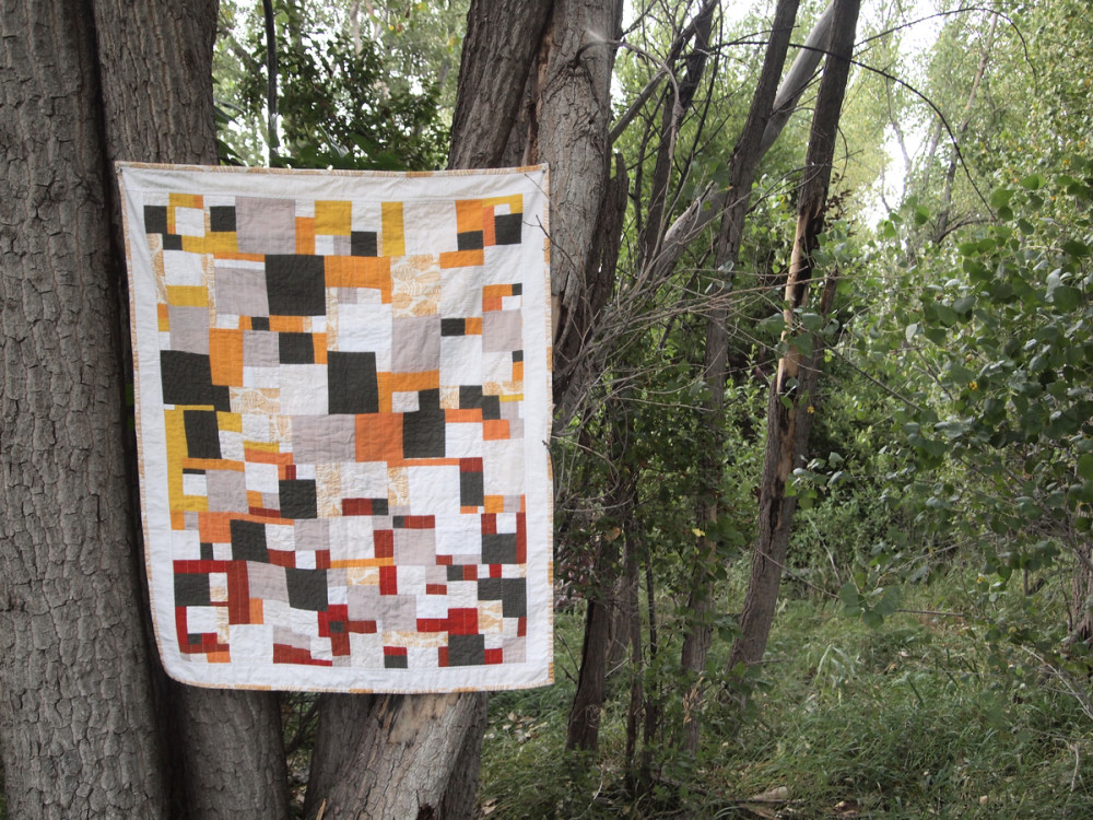 Quilt no. 016: Floating Squares. 2015. Various quilting cottons. 34″ x 43″