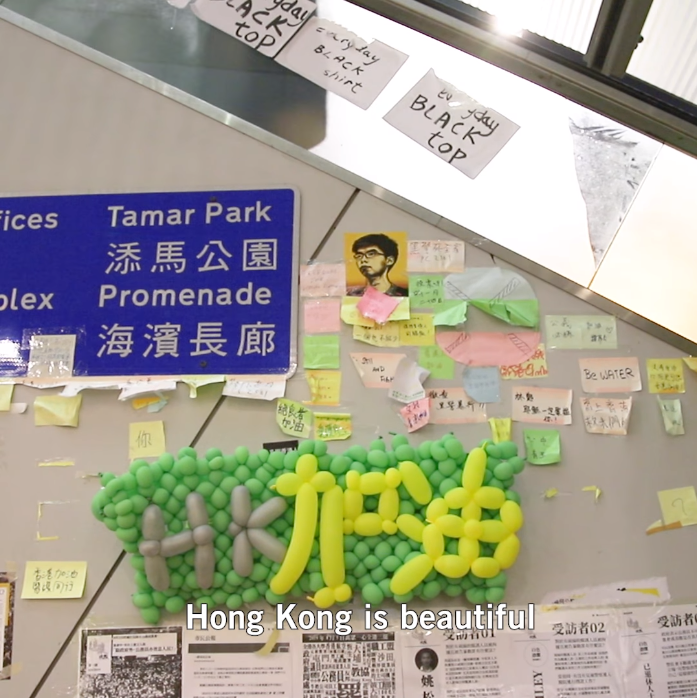 Ảnh của nhà hoạt động dân chủ trẻ Hoàng Chí Phong được người ngưỡng mộ gắn trên một bức tường.