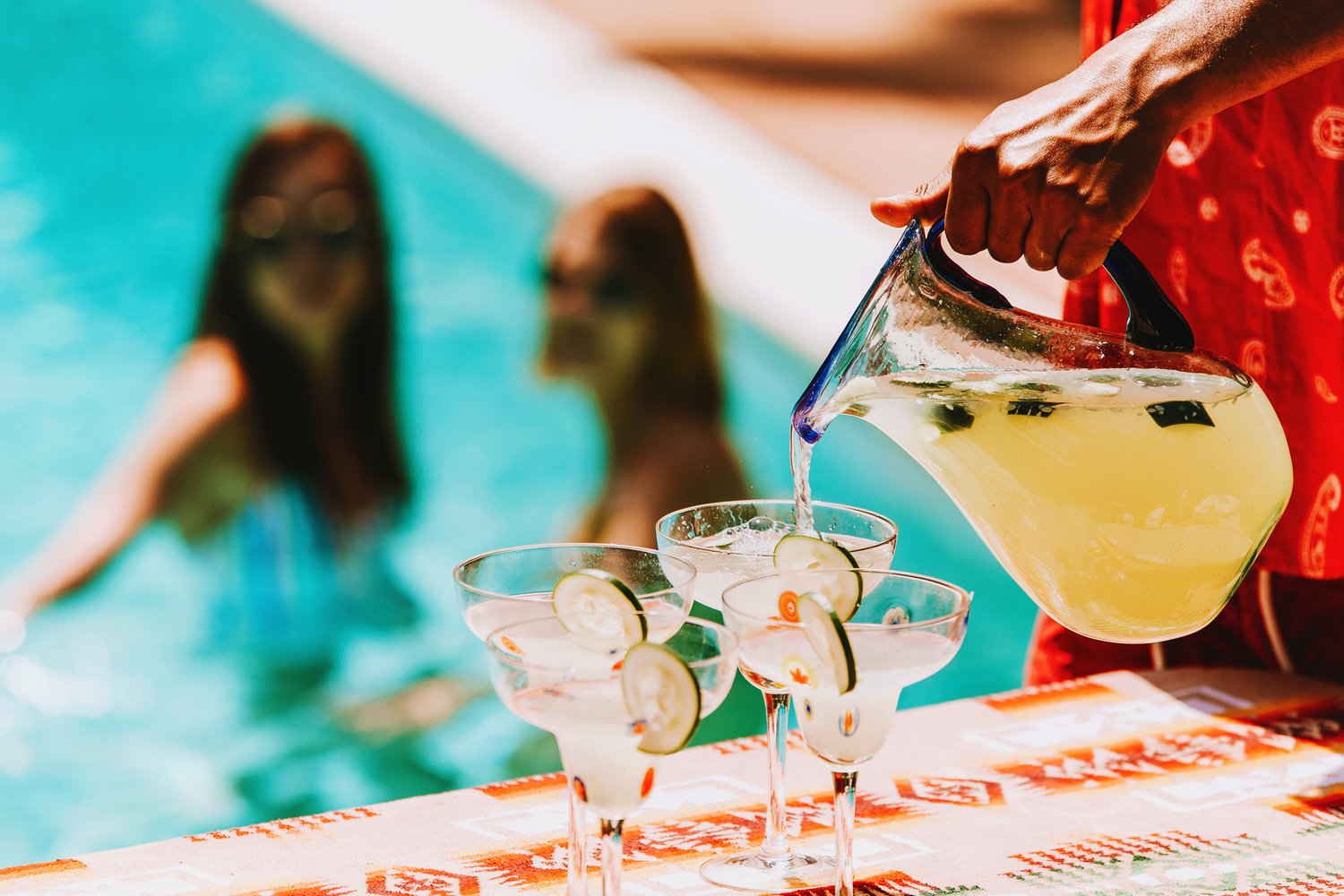 Step 1: Prep the cocktails ahead of time. Step 2: Jump in pool.   Photo by Joey Wharton.