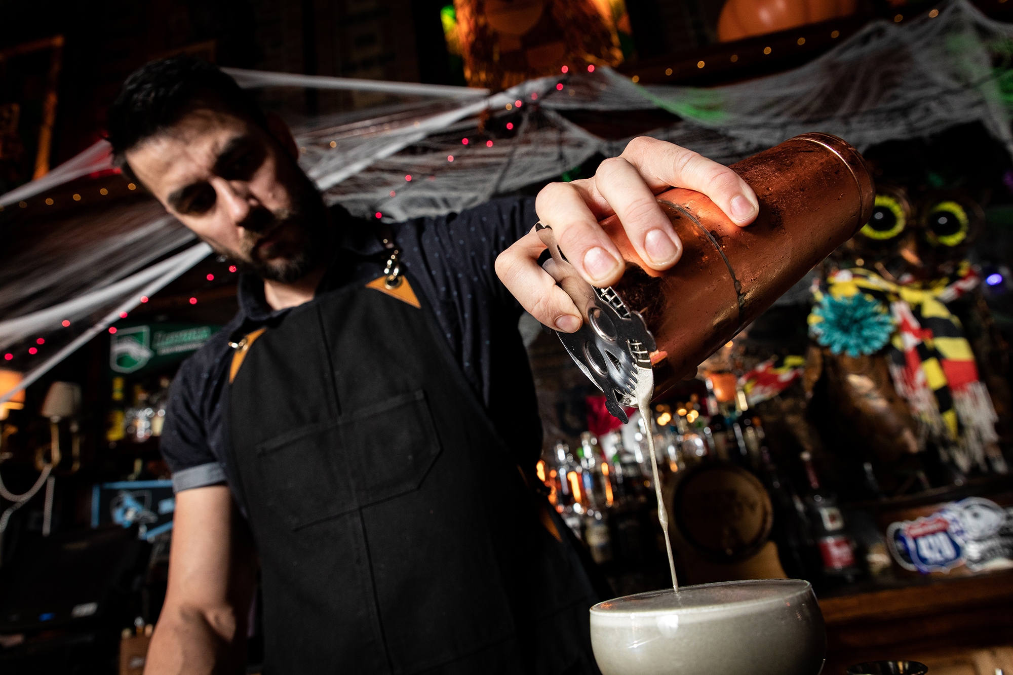 The Owl Bar's Bar Manager Joe Aldridge pours up some dark magic.   All photos by    Justin Tsucalas   .