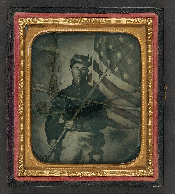 Soldier in Union Uniform with Bayoneted Musket in Front of American Flag | Circa 1861-1865