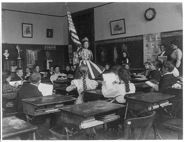 Public School Students in Art Class Sketching Live Model Wearing Stars and Stripes Dress and Holding U.S. Flag, 3rd Division Washington, D.C. | Circa 1899