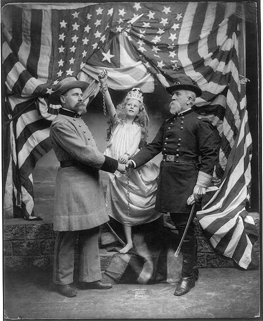 Union and Confederate Soldier Shaking Hands in Front of Young Female Personification of Cuba with Broken Shackles and a Large Flag in the Background | Circa 1898