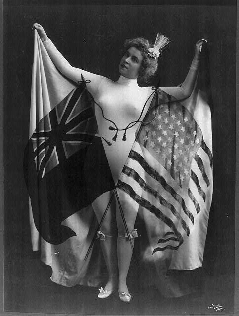 Woman in White Body Suit Holding Spread Cap with Superimposed US and British Flags | Circa 1899
