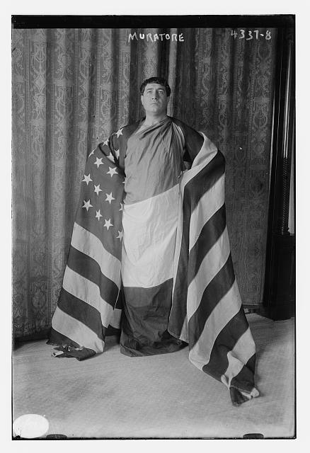 Muratore Draped in the American Flag | Circa 1900
