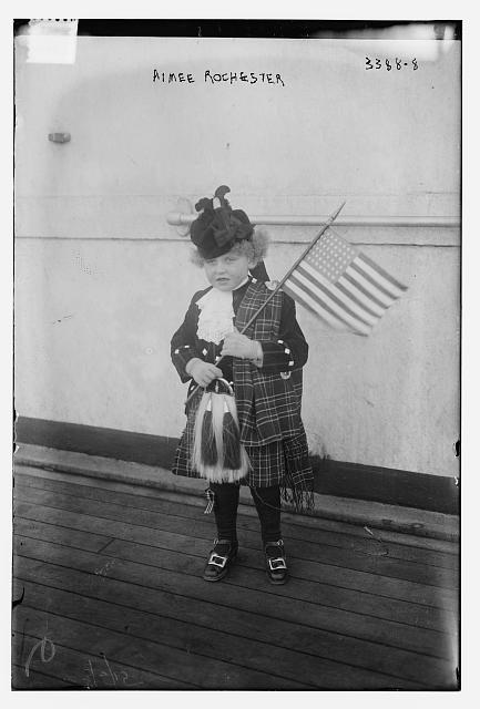 Aimee Rochester in Scottish Kilt Holding an American Flag | Circa 1910