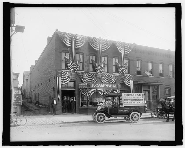 J.F. Campbell Hardware & Stoves Deorated with American Flags | Circa 1919