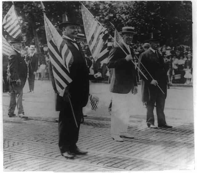 Woodrow Wilson Carrying Flag in Parade | Circa 1916
