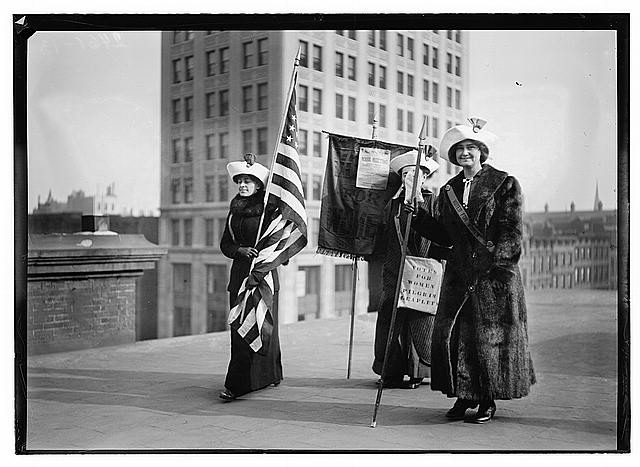 Three Suffragettes with Leaflets and the US Flag | Circa 1910
