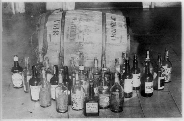 Bottles and a Barrel of Confiscated Whiskey   Circa 1921