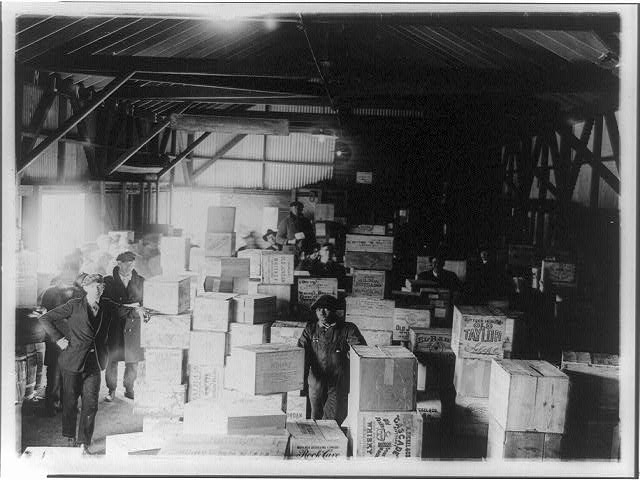 Men Standing in Warehouse with Cases of Confiscated Liquor   Circa 1921