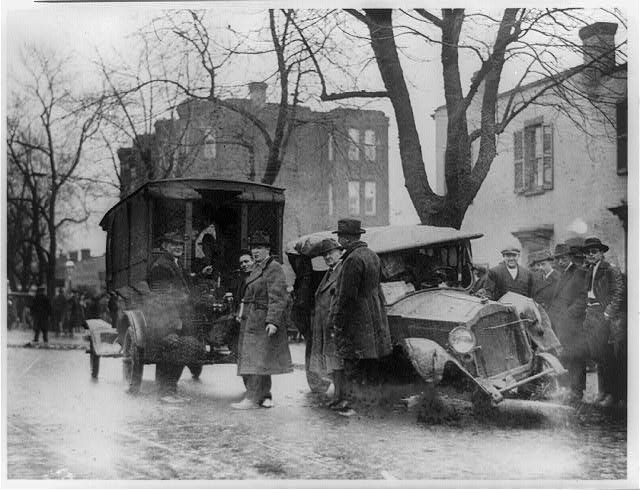 The Aftermath of a Thrilling Chase Through the Busiest Streets of Washing, a Pair of Bootleggers and Their Car Come to Grief at the Hands of the Capitol Police   Circa 1922