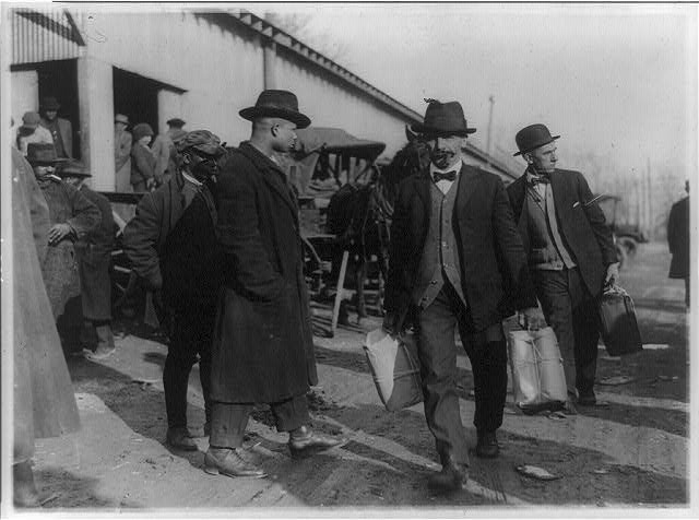 Two Men of the US Internal Revenue Bureau Carrying Packages of Confiscated Liquor   Circa 1921
