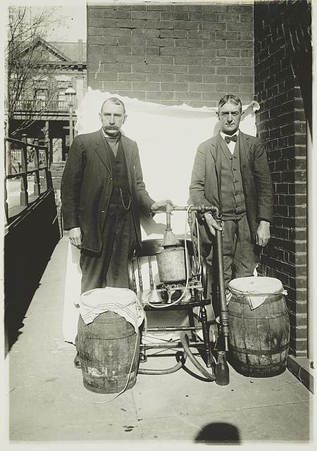 Two Men Posing with a Whiskey Still   Circa 1920