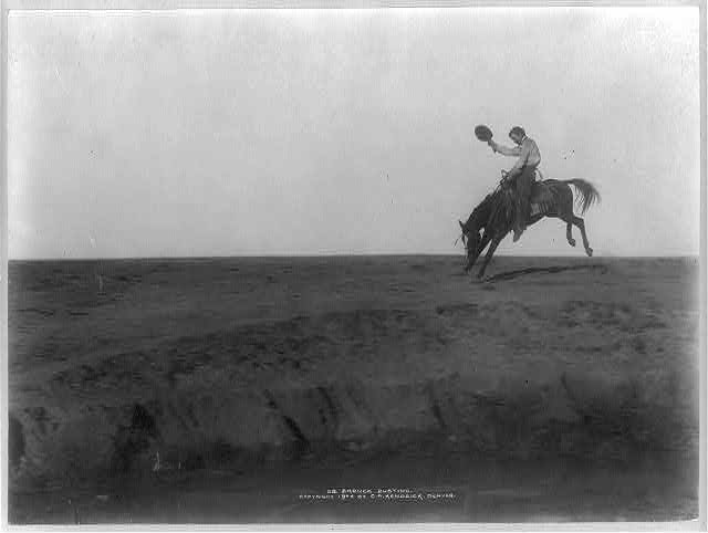 Cowboy Riding a Bucking Bronco on the Plains, Probably on the XIT Ranch in the Texas Panhandle | Circa 1904