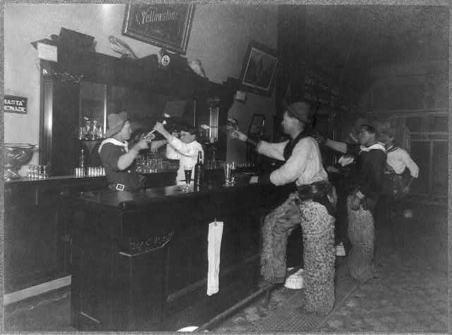 Cowboy, Holding a Gun, Fighting with the Bartender, Three Other Cowboys Stand at the Bar with Guns Drawn | Circa 1907