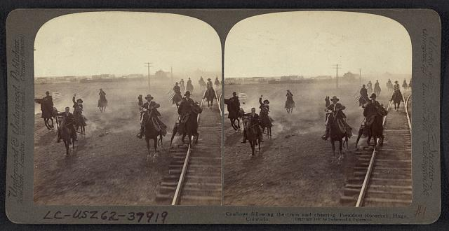 Cowboys Following the Train and Cheering President Roosevelt in Hugo, Colorado | Circa 1903