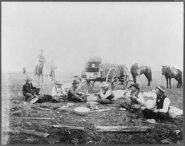 Cowboys Having Breakfast Near a Chuck Wagon | Circa 1905