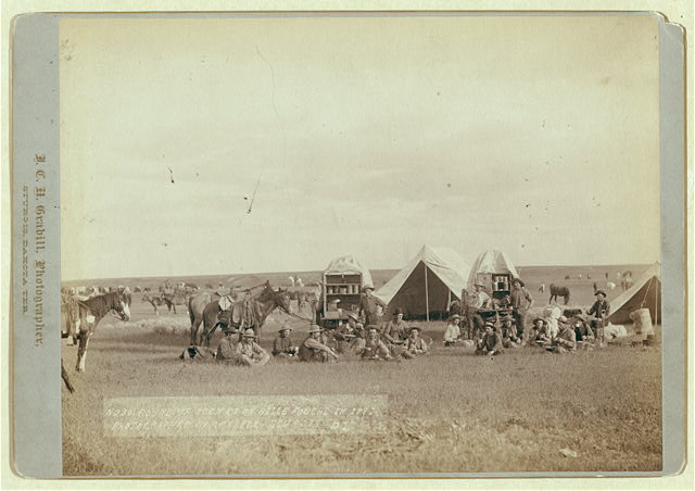 Cowboys Seated Around Chuckwagon at Campsite | Circa 1887