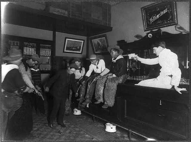 Seven Men in a Saloon Shooting Down at the Floor Forcing Another Man to Dance | Circa 1907