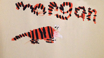 This girl carried her tiger's stripe pattern into the design of the letters in her name!