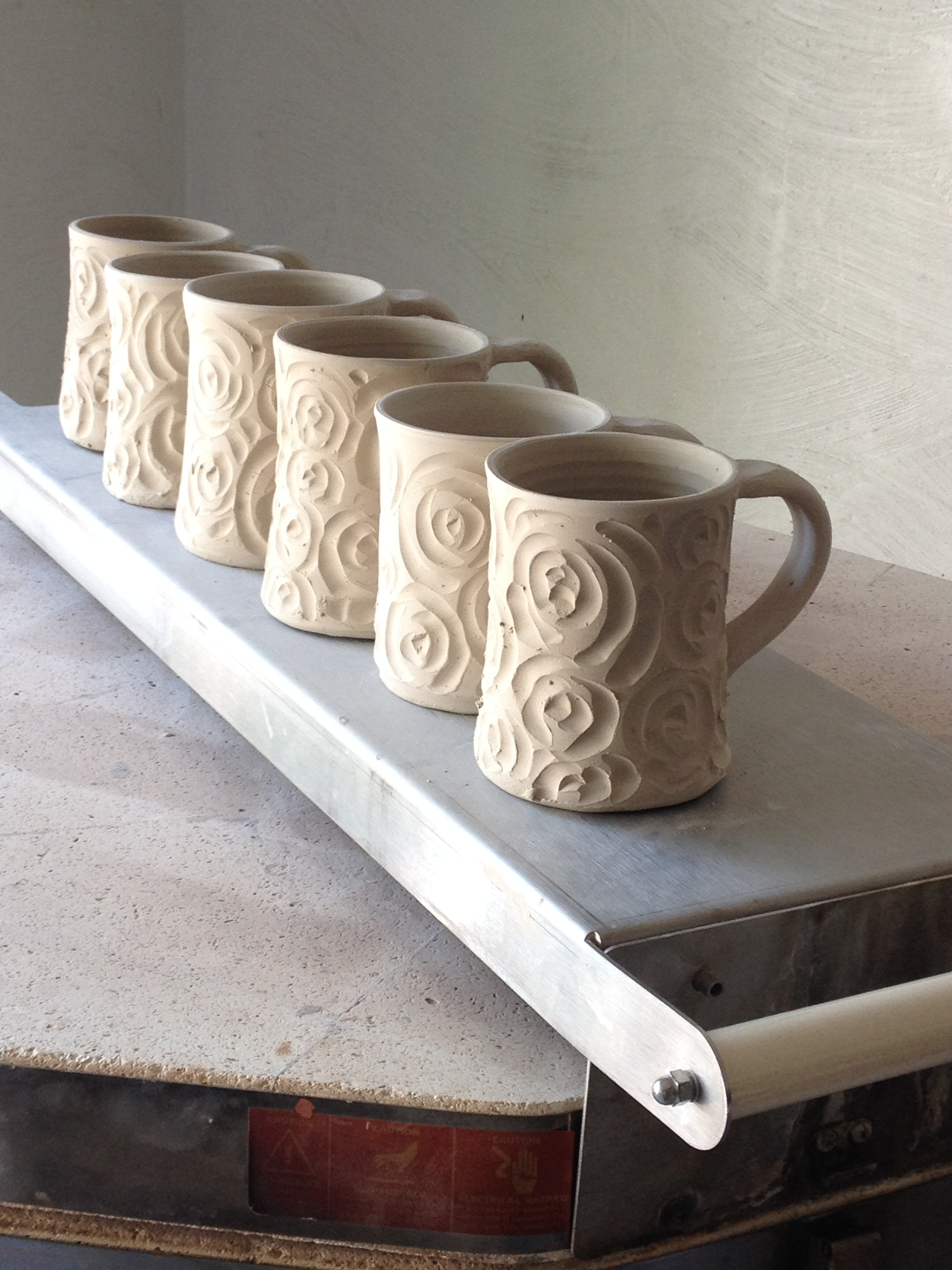 Carved mugs drying.jpg