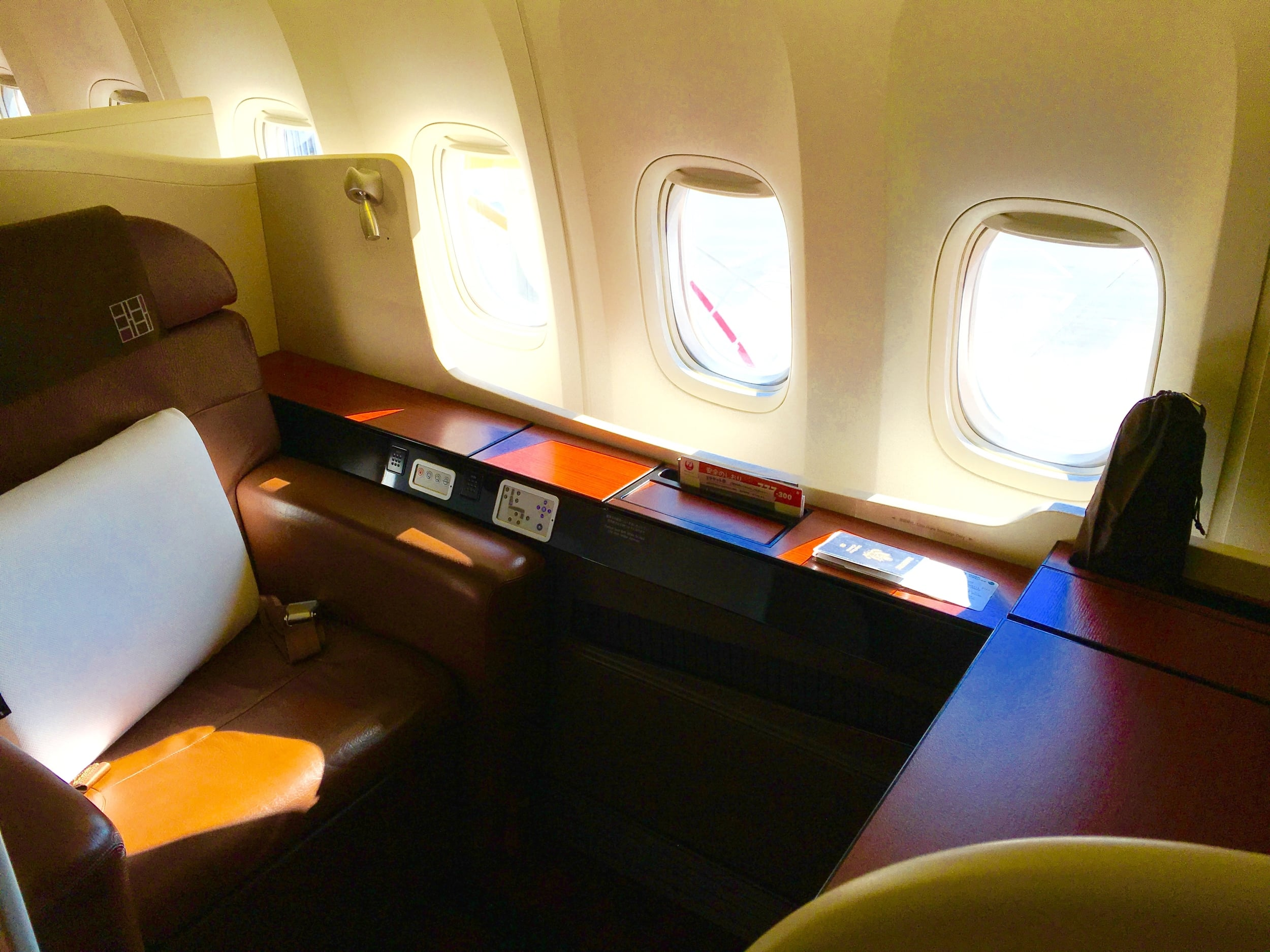 My spacious window seat in first class, 1A. 4 windows length.