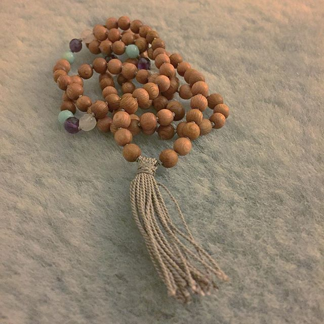 Rose quartz, amethyst, & amazonite sparkle with rosewood in this sweet new mala. • • • #decadentwellness #everyday #handmadewithlove #jewelry #handmade #mala #108 #yoga #wearyouryoga #betweenyogaclasses #crystals #soundhealing #malamagic #magic #japa #meditation #morning #prayer